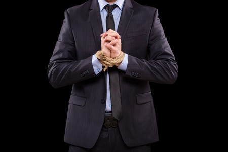 bonding rope: Businessmen tied hand. isolated on a black background Stock Photo