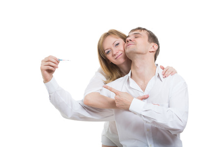 test de grossesse: Smiling Young Couple Finding Out Results Of A Pregnancy Test Banque d'images