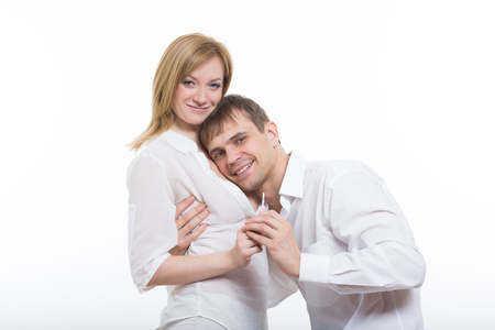 finding out: Smiling Young Couple Finding Out Results Of A Pregnancy Test Stock Photo