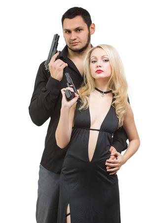 pistola: Investigación secreta. Hombre agente mujer detective de espionaje criminal y atractiva con el arma. Aislado en el fondo blanco. Foto de archivo