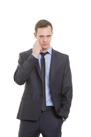 comunicacion no verbal: gestos desconf�an de mentiras. lenguaje corporal. un hombre en un traje de negocios aislados sobre fondo blanco