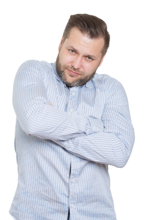 adult male with a beard. isolated white background. Closed defensive posture. crossed arms. body language