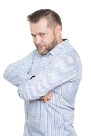 sullenly: adult male with a beard. isolated on white background. Closed defensive posture. crossed arms. body language