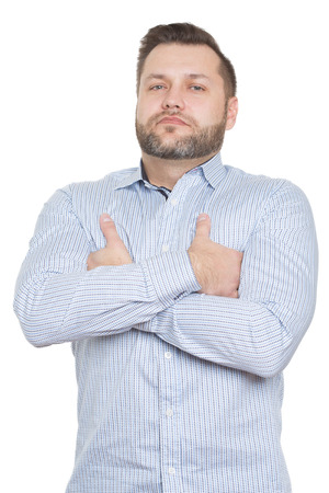 nonverbal communication: adult male with a beard. isolated white background. demonstration of superiority