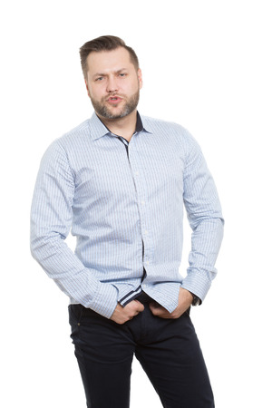 causing: causing sexual pose. adult male with a beard. isolated white background. Stock Photo