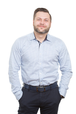 unwillingness: male with a beard. isolated white background. hands in his pockets. distrust posture Stock Photo