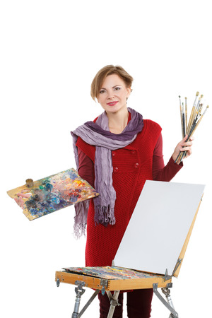 white work: Artist woman at work. Isolated on a white background