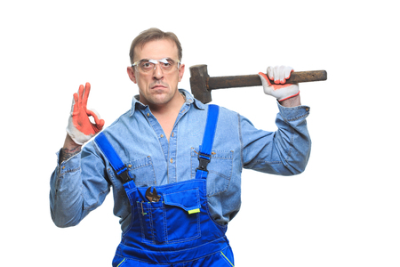 Workers in protective glasses with a sledgehammer. isolated on white background