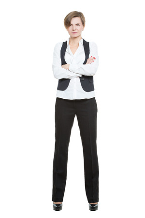 businesswoman legs: Portrait in full growth. Businesswoman legs wide apart. isolated on white background. closed pose, arms crossed Stock Photo