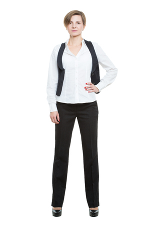 businesswoman legs: Portrait in full growth. Businesswoman legs wide apart. open posture. hand on the side.  isolated on white background Stock Photo