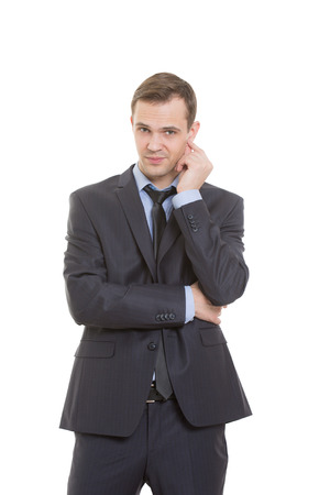 nonverbal: body language. man in business suit isolated on white background. scratching, rubbing the ear. gesture of distrust speaker