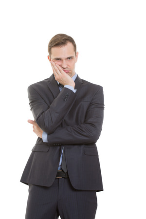 nonverbal: body language. man in business suit isolated white background. Propping palm cheeks and chin. a gesture of boredom