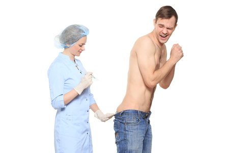 prick: Woman doctor puts a prick. The man is afraid and feels panic Stock Photo