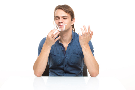 slut: man stained cream. isolated on white background Stock Photo