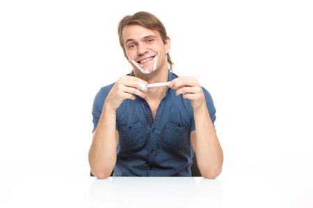 slut: man stained cream. isolated on white background Stock Photo