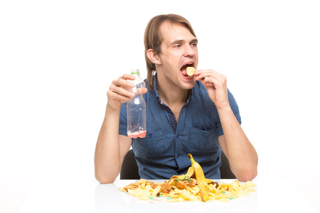 cesspool: male slut drinking soda and eating chips. desk cesspool