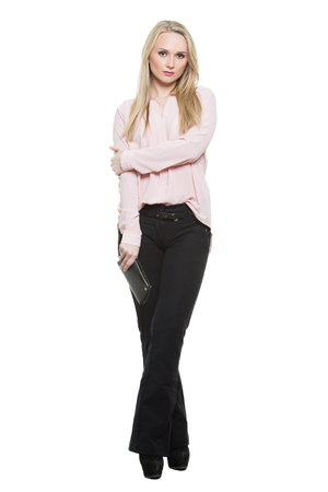 tightness: girl in pants and blous.  Isolated on white background. body language