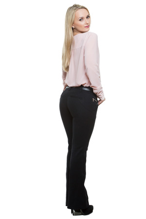 sidelong: girl in pants and blous.  Isolated on white background. body language.
