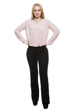 legs wide open: girl in pants and blous.  Isolated on white background. body language.