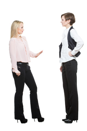 nonverbal: two businesswomen, isolated on white background. body language, gestures psychology. paired gestures Stock Photo