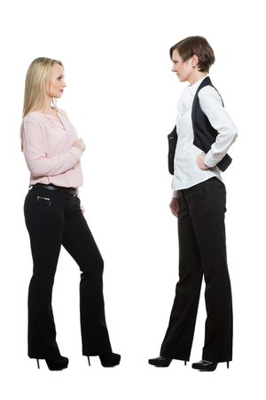 body work: two businesswomen, isolated on white background. body language, gestures psychology. paired gestures Stock Photo