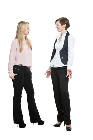 justification: two businesswomen, isolated on white background. body language, gestures psychology. paired gestures Stock Photo