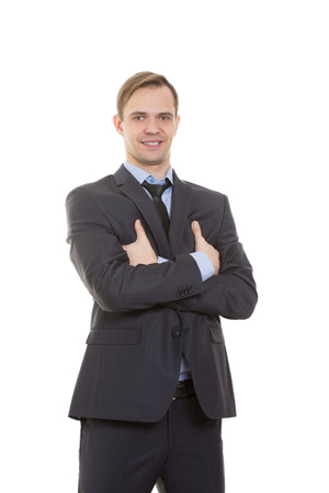 superiority: body language. man in business suit isolated on white background. gestures of arms and hands. posture of superiority. emphasis thumbs