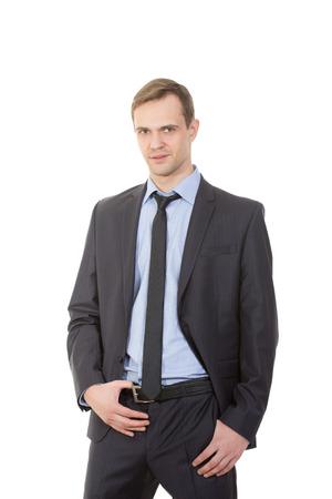 genitali: linguaggio del corpo. uomo in giacca e cravatta isolato su sfondo bianco. Archivio Fotografico