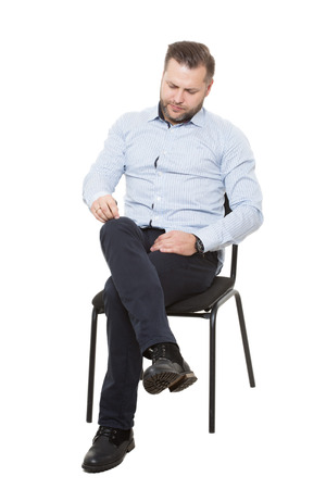 nonexistent: man sitting on chair. Isolated white background