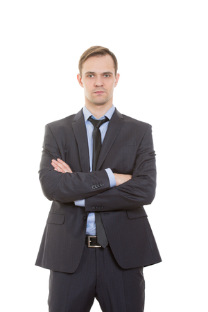 emphasis: body language. man in business suit isolated on white background. gestures of arms and hands. posture of superiority. emphasis thumbs
