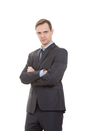 nonverbal communication: body language. man in business suit isolated on white background. gestures of arms and hands. posture of superiority. emphasis thumbs