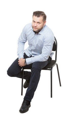 starting position: man sitting on chair. Isolated white background. gesture of readiness for action. starting position