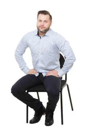 nonverbal communication: man sitting on chair. Isolated white background