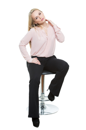 bar stool: Elegant beautiful woman sitting on a contemporary metal bar stool.  isolated on white Stock Photo