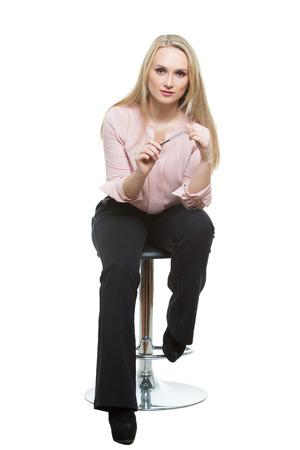 phallic: Elegant beautiful woman sitting on a contemporary metal bar stool.  isolated on white Stock Photo