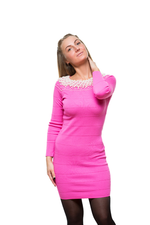 long sleeves: fashion young girl stay straight in woolen pink dress with long sleeves. beaded Stock Photo
