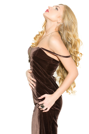 arousal: Sexy fashionable curly blonde with bright makeup. Sexual arousal girl in a short dress