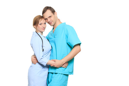 inappropriate: A male and a female doctor kissing at work. Stock Photo