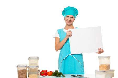 relies: attractive girl chef with a white plate. Isolated on white background