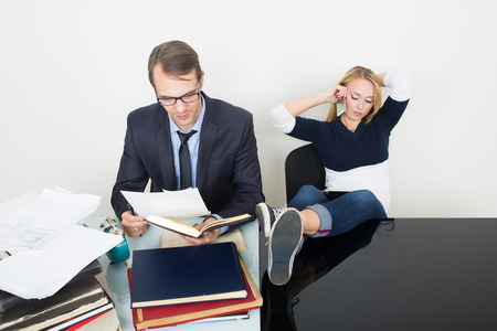 slacker: woman prevents a man to work. talking on the phone. It distracts from the business.