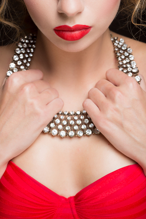 neck girl: necklace on female neck. girl holding hands. sexy red lips.