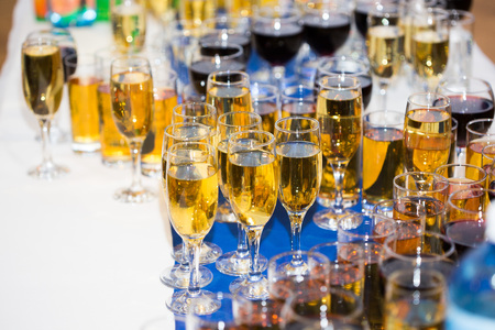 skoal: Glasses with champagne on the party table Stock Photo