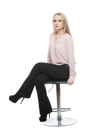 Elegant beautiful woman sitting on a contemporary metal bar stool.  isolated on white. Training managers. sales agents. non-verbal communication.
