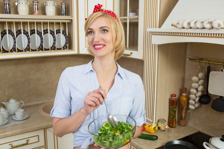 bawl: Portrait of a girl looking positive and holding a bawl with salad