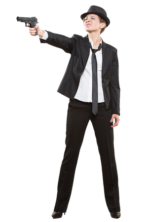 gangster girl: beautiful girl gangster holding a gun. Classic suit and hat Stock Photo