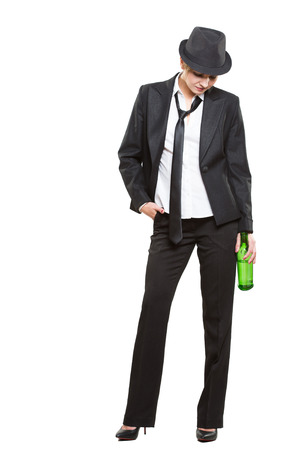 booze: businesswoman wearing a hat and tie, holding a bottle of alcohol.