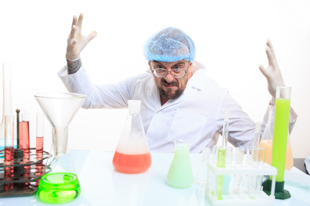 Mad chemist in the lab doing reaction - studio shoot Stock Photo