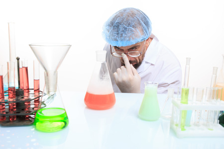boiling tube: Mad chemist in the lab doing reaction - studio shoot Stock Photo