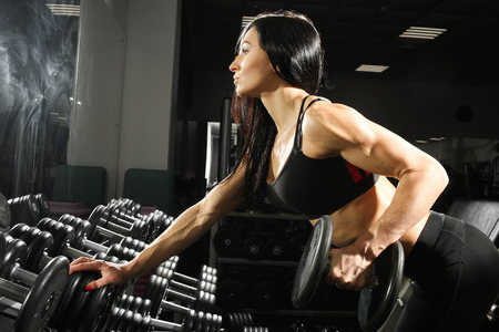 sexy breasts: Nice sexy woman doing workout with dumbbells  in gym