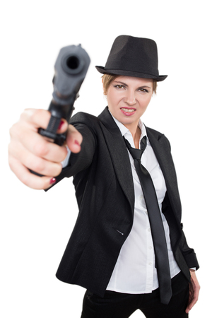 gangster girl: beautiful girl gangster holding a gun. Classic suit and hat. isolated on white background